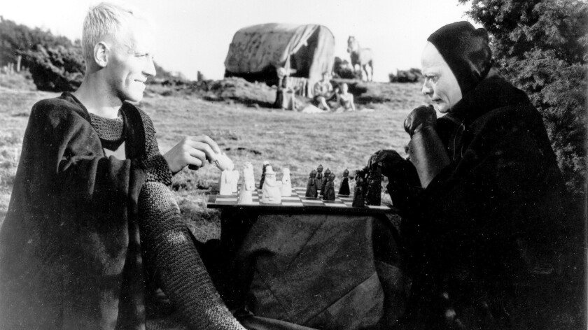 """Antonius Block (Max von Sydow) challenges Death (Bengt Ekerot) to a game of chess in """"The Seventh Seal"""" (1956)."""
