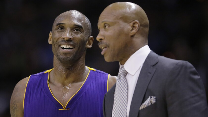 Lakers star Kobe Bryant, left, speaks with Coach Byron Scott during a game against the San Antonio Spurs last December.