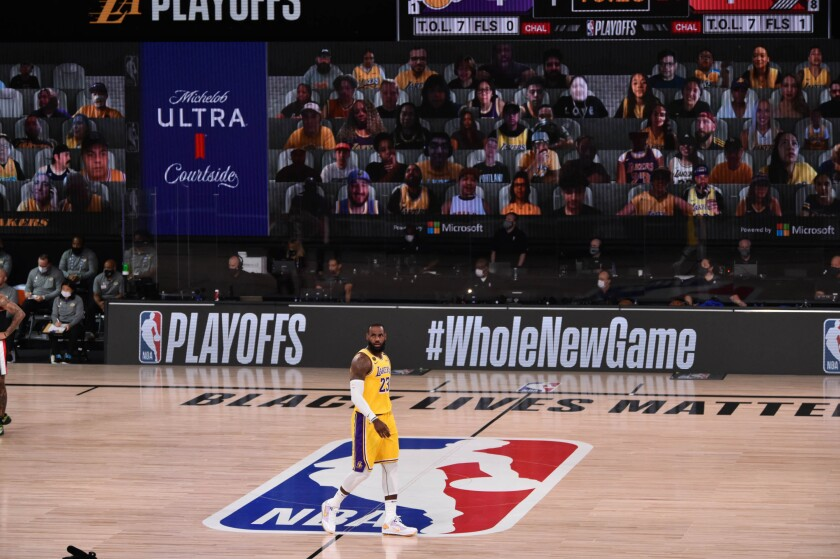LeBron James makes his way down court under the watchful eyes of Lakers fans via the digital videoboard.