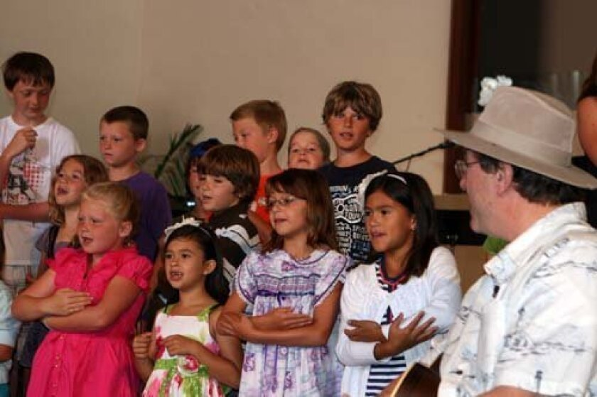 The students perform as Pastor Clay Ford looks on.  Photo: Karen Ogren