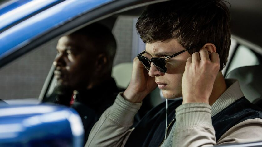 """Ansel Elgort, right, and Jamie Foxx in a """"Baby Driver,"""" in theaters on Aug. 11."""