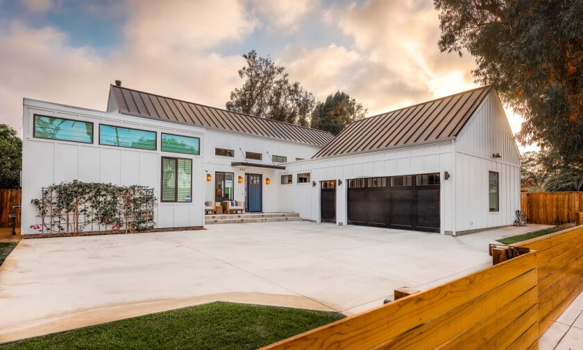 Built in 2015, the modern farmhouse opens to a private backyard with a lounge, swimming pool and spa.