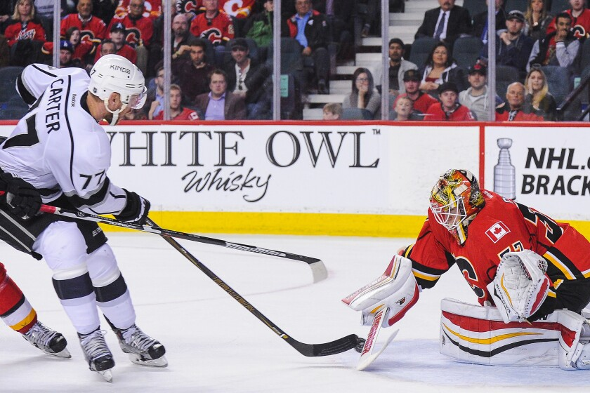 Jeff Carter scores on the Flames 40 seconds into overtime to give the Kings a 5-4 win in Calgary on April 5.