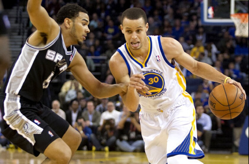 Stephen Curry and the Golden State Warriors stole home-court advantage with a Game 2 victory in San Antonio over the Spurs.