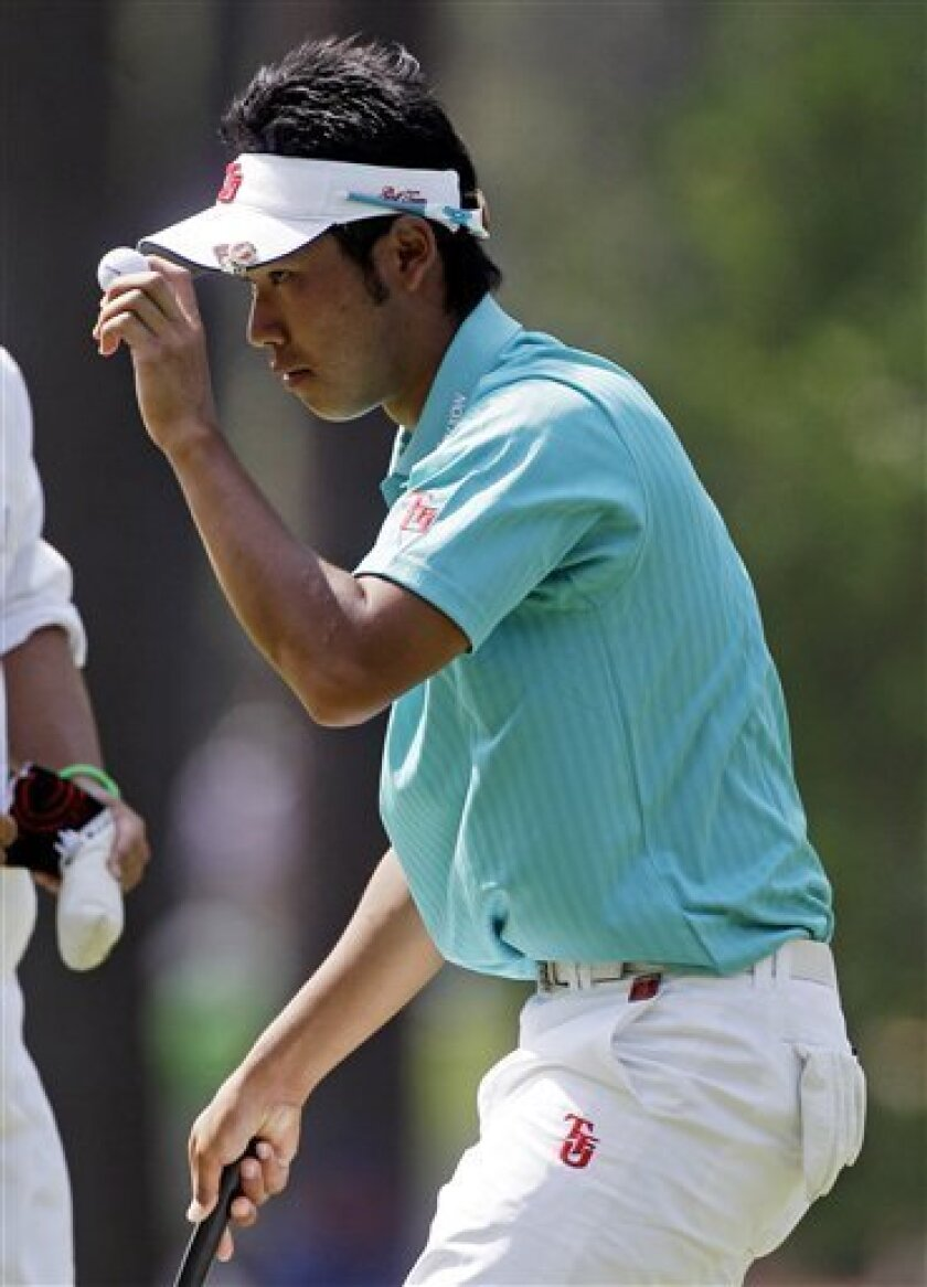 Hideki Matsuyama of Japan tips his cap after a birdie on the third hole during the third round of the Masters golf tournament Saturday, April 9, 2011, in Augusta, Ga. (AP Photo/Chris O'Meara)
