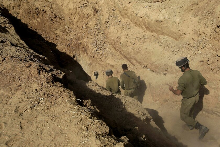 FILE - In this Sunday, Oct. 13, 2013 file photo, Israeli soldiers enter a tunnel discovered near the Israel Gaza border. Israel's military chief Lt. Gen. Gadi Eisenkot said Tuesday, Feb. 9, 2016, that Gaza's Hamas rulers have been rebuilding the sophisticated network of underground tunnels that Isr