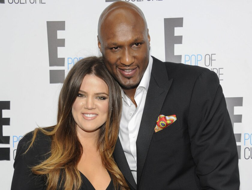 Khloe Kardashian and Lamar Odom, seen here in 2012, reported a major theft at their former home Monday. Kardashian filed for divorce in December.