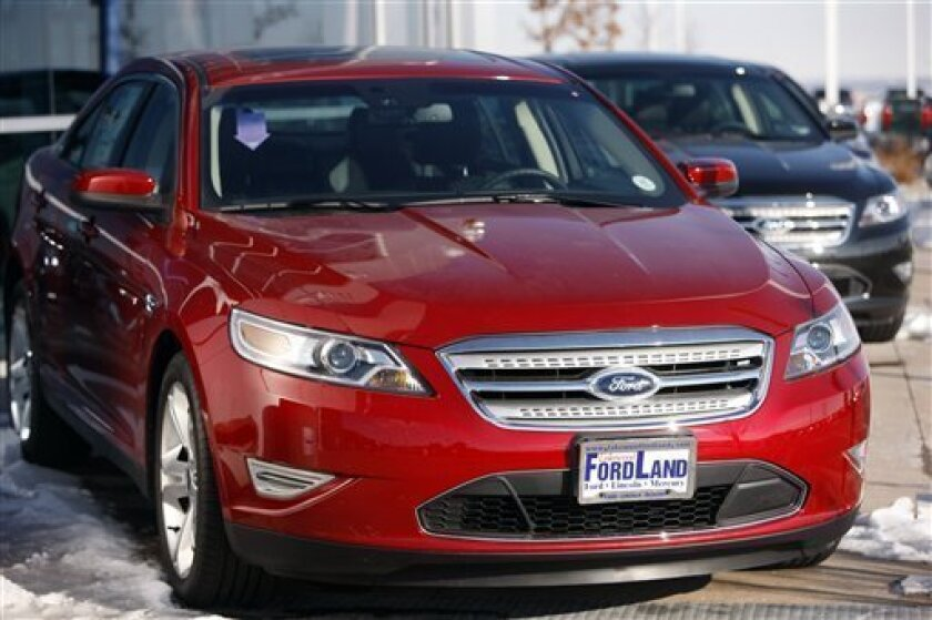 In this Dec. 27, 2009 photo, 2010 Taurus sedans sit at a Ford dealership in Lakewood, Colo. Ford Motor Co. said Tuesday, Feb. 2, 2010, sales rose 25 percent in January, buoyed by a stronger economy and Toyota's decision to halt U.S. sales because of a gas pedal system problem. (AP Photo/David Zalubowski)