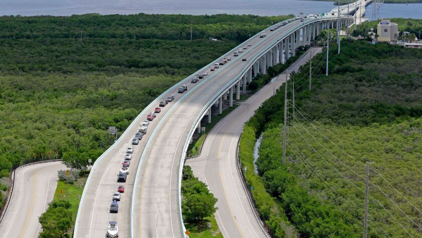Hurricane Irma has forced cruise lines to cancel or change itineraries. In Florida, travelers on U.S. 1 drove north Sept. 6 to flee the Key Largo area.