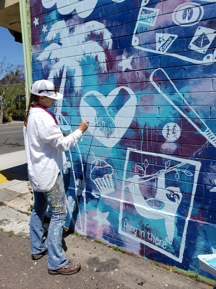 """Mural artist Hanna Daly puts the finishing touches on """"Quarantine Dreams"""" at Fresheria restaurant at 627 Pearl St."""