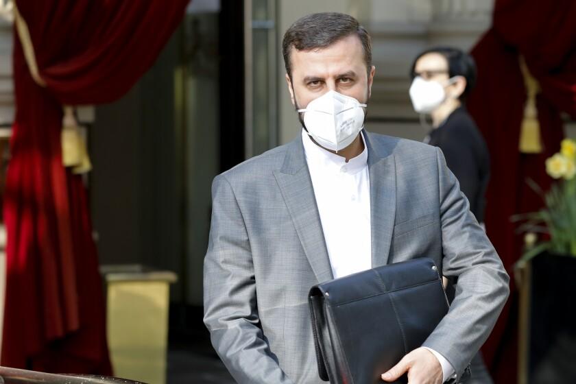Iran's Governor to the International Atomic Energy Agency (IAEA), Kazem Gharib Abadi leaves the 'Grand Hotel Wien' where closed-door nuclear talks take place in Vienna, Austria, Saturday, May 1, 2021. (AP Photo/Lisa Leutner)