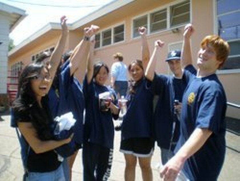 Rotaract Club Members show their support for Nativity Prep Academy serving low-income youth in inner-city San Diego.