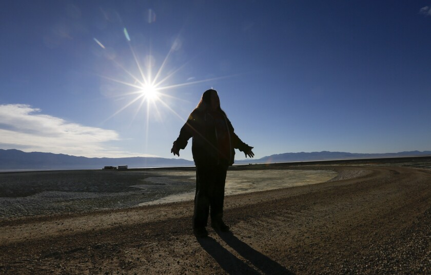 Kathy Jefferson Bancroft stands in the middle of the dusty, saline Owens Lake. With a season of record snowfall in the Sierras, the Owens Valley is preparing for possible floods when everything starts melting.