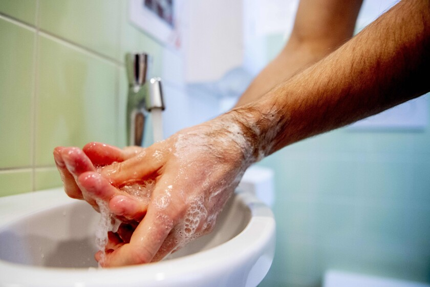 Health worker washing his hands
