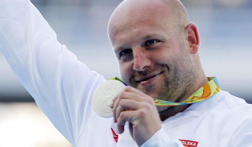 Silver medalist Piotr Malachowski of Poland poses during the medal ceremony for the men's discus throw during the Rio Olympic Games on Aug. 13.