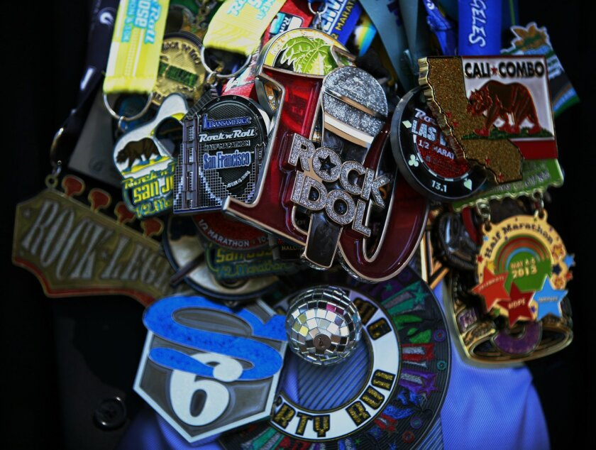 Erwin Castillo, 40, amassed dozens of medals and race memorabilia including from 13 half marathons he ran in 2013 and 14 endurance events in 2014. Castillo's favorite medal is from the Marine Corps half marathon.