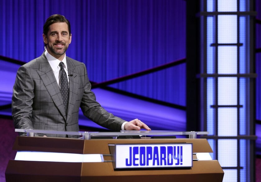 """This image released by Jeopardy Productions, Inc. shows Green Bay Packers quarterback Aaron Rodgers as he guest hosts the game show """"Jeopardy!"""" Rodgers is hosting the popular game show for the next two weeks as the show goes through a series of guest hosts to replace Alex Trebek, who died of cancer on Nov. 8. (Carol Kaelson/Jeopardy Productions, Inc. via AP)"""