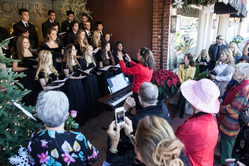 A choir performs in front of Adelaide's during last year's Holiday Open House.