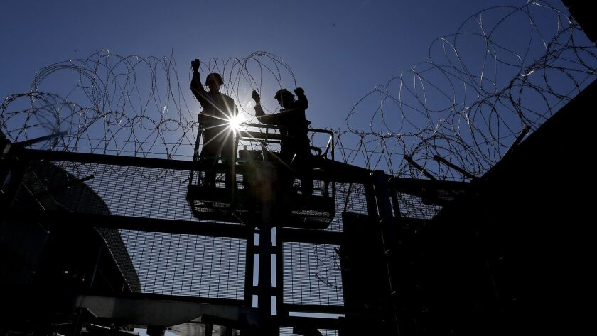 SAN YSIDRO, CALIF. - NOV. 16, 2018. Marines from Camp Pendleton install razor wire at the pedestrian