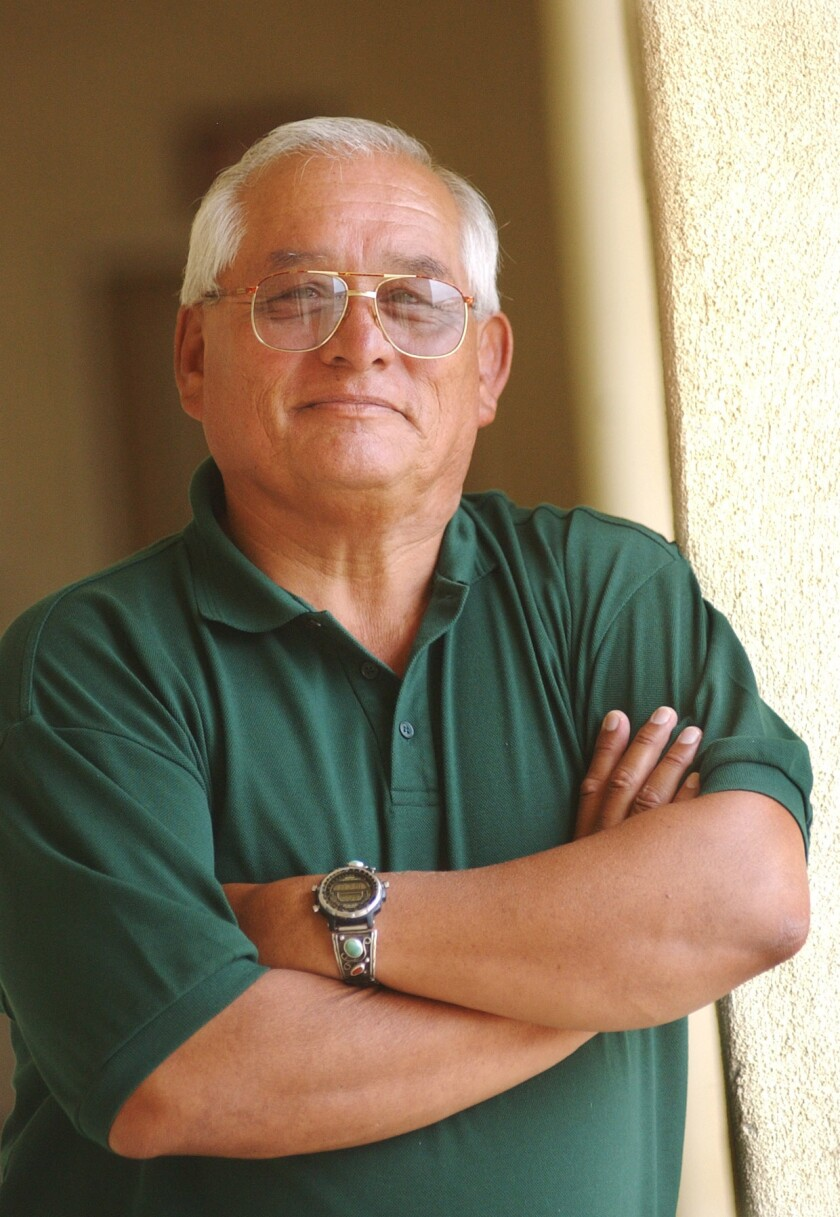 Gus Chavez stands in his office at SDSU on his last day at work on August 22, 2003. Chavez had been director of the Educational Opportunity Program for nearly 30 years.