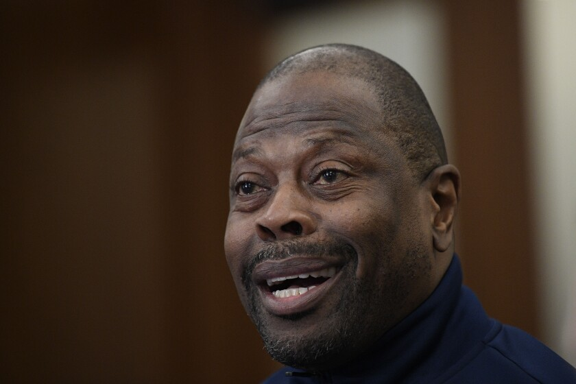 """Georgetown head coach Patrick Ewing speaks during an NCAA college basketball media availability, Wednesday, Dec. 11, 2019, in Washington. It was hard not to do a double-take when Georgetown basketball coach Patrick Ewing replied to a question Wednesday about whether his full roster will be available for the team's next game, against Syracuse, by saying, """"As of now, yes."""" That'll be the Hoyas' first home contest since legal matters involving players came to light.(AP Photo/Nick Wass)"""