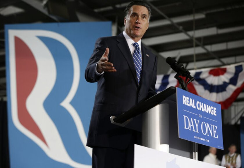 Mitt Romney speaks at a campaign stop at the Wisconsin Products Pavilion at State Fair Park in West Allis, Wis.