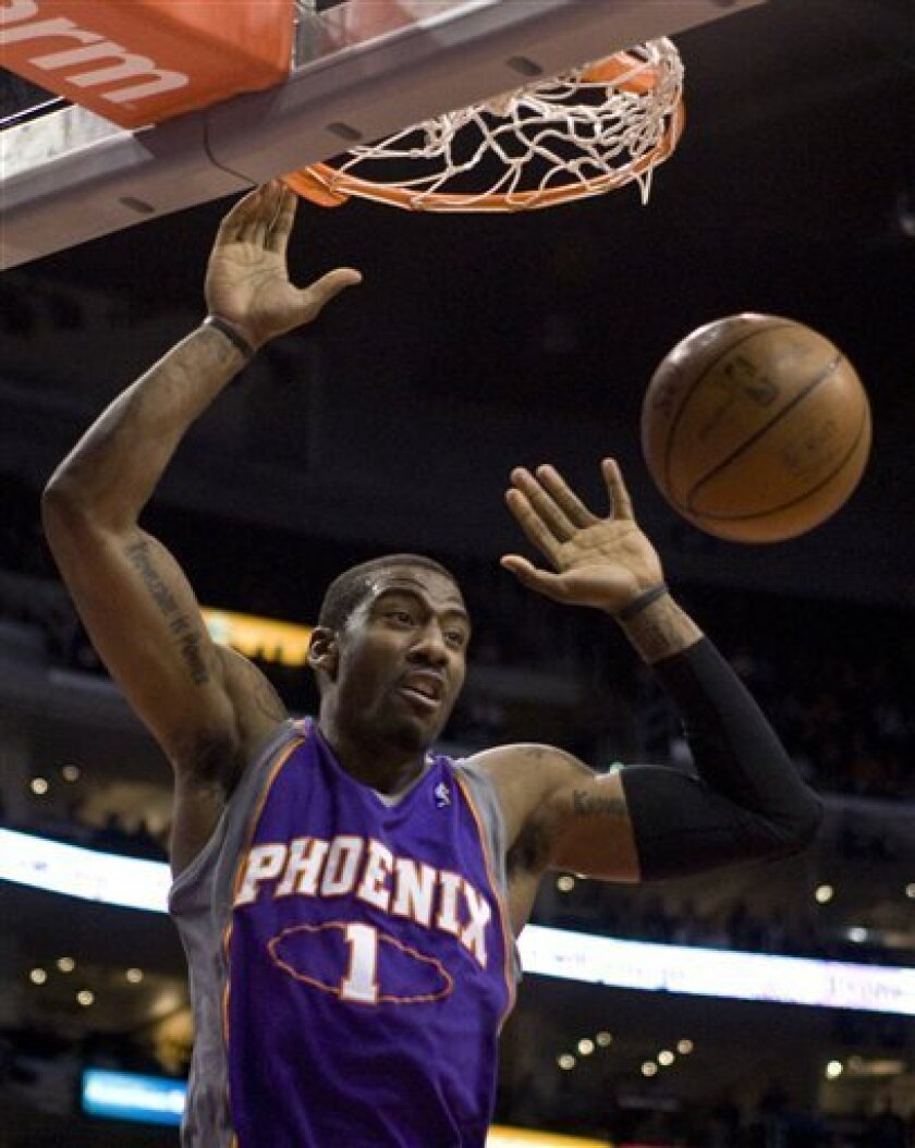 This Feb. 18, 2009 file photo shows Phoenix Suns' Amare Stoudemire scoring against the Los Angeles Clippers during the first quarter of an NBA basketball game in Los Angeles. The Phoenix Suns say Stoudemire will be out about eight weeks after eye surgery. The surgery to repair a partially detached