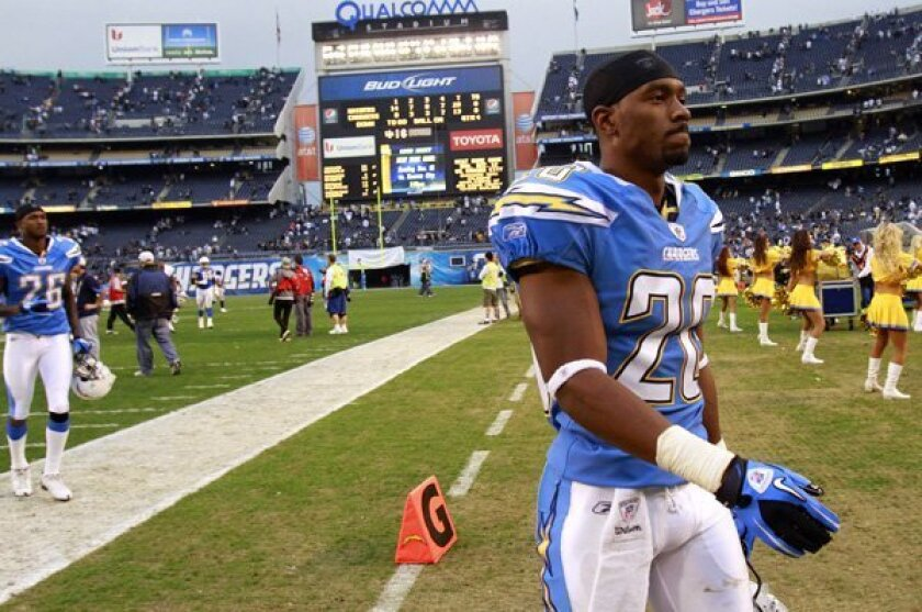 Chargers Antoine Cason walks off after a loss to the Raiders.