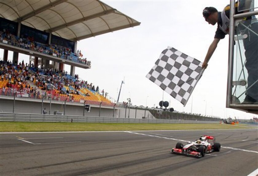 McLaren Mercedes driver Lewis Hamilton of Britain crosses the finish line to win the Turkish Formula One Grand Prix at the Istanbul Park circuit racetrack, in Istanbul, Turkey, Sunday, May 30, 2010. (AP Photo/Luca Bruno)