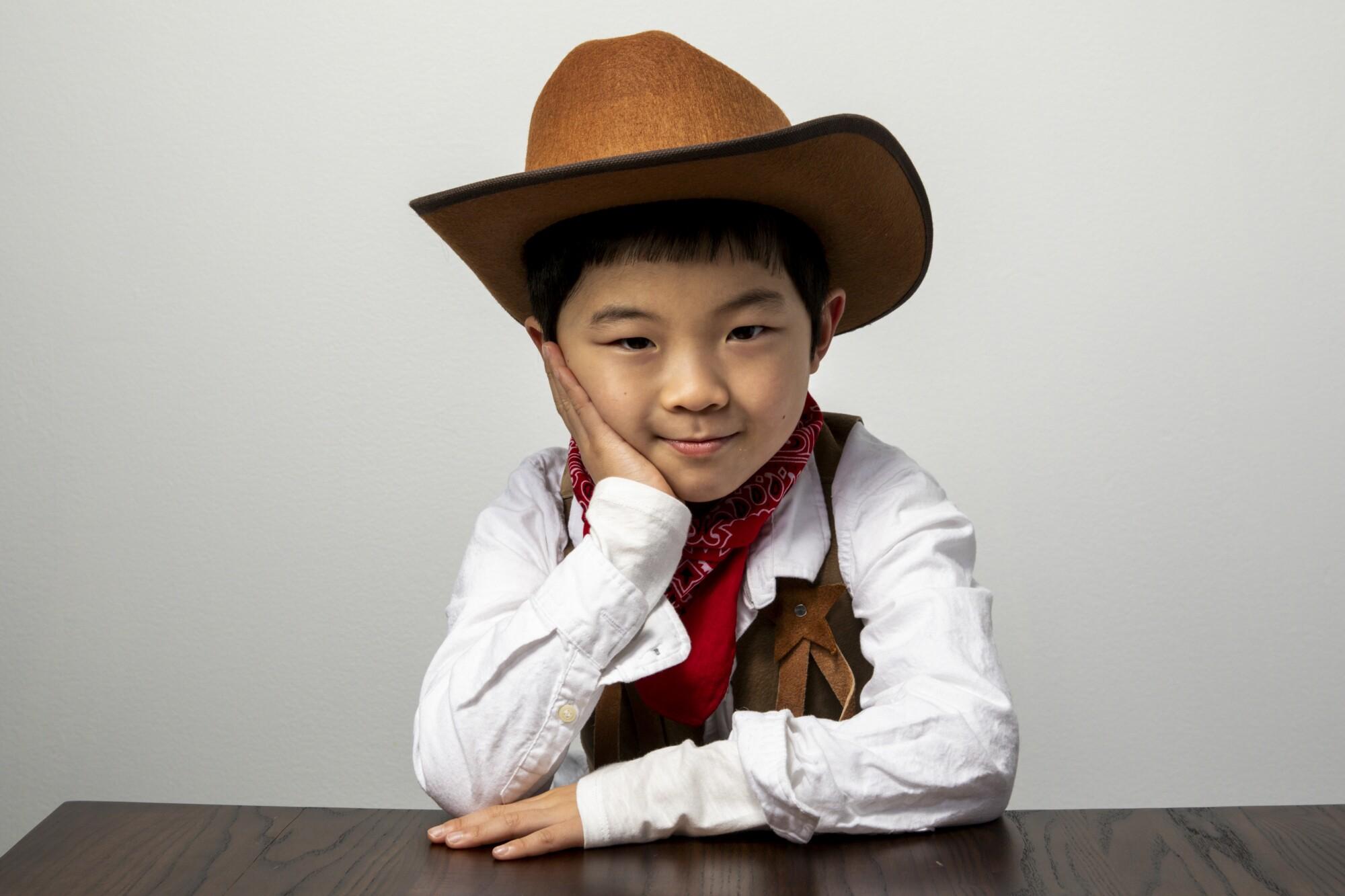 "Alan Kim wears a cowboy outfit to a ""Minari"" photo shoot at the 2020 Sundance Film Festival."
