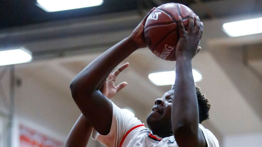 Hoover's James Malveaux shoots for two in the third period against Sweetwater.