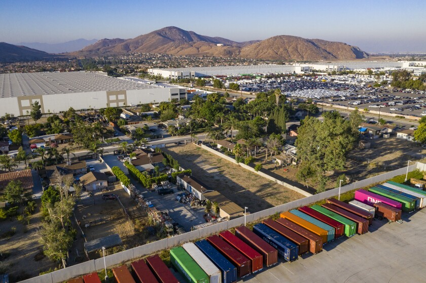 An aerial view of warehouses and multicolored storage units in Fontana.