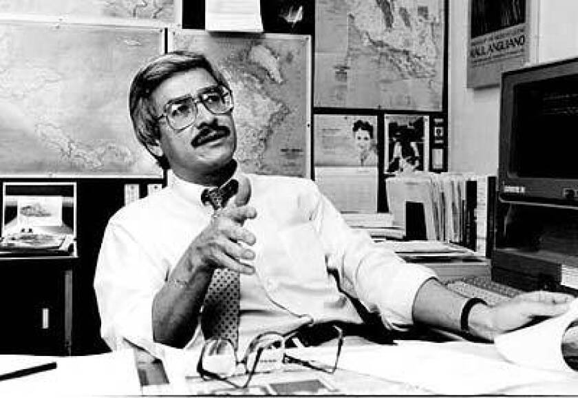 Frank del Olmo at his desk at the L.A. Times in 1991.