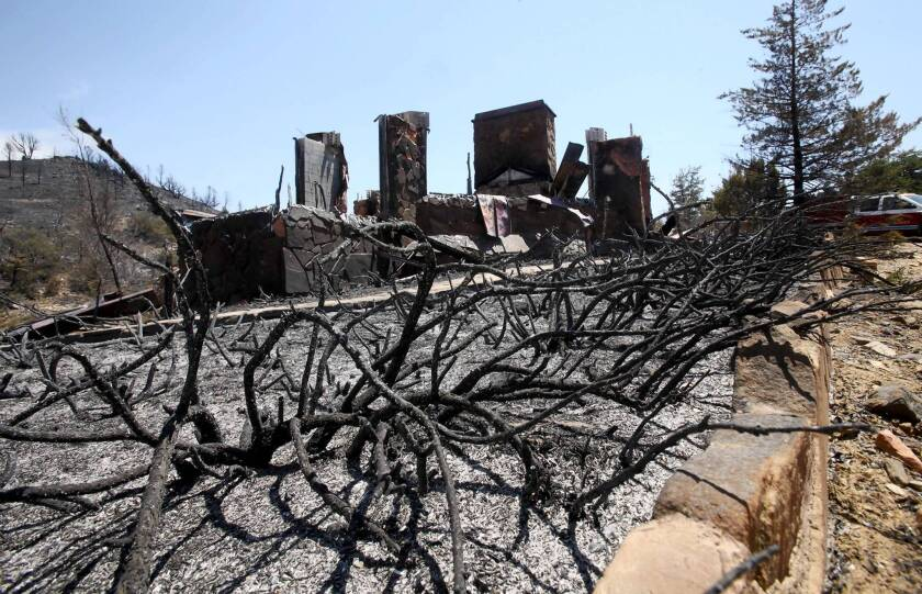 A burned home in Peeples Valley, Ariz., near where 19 firefighters died battling the blaze.