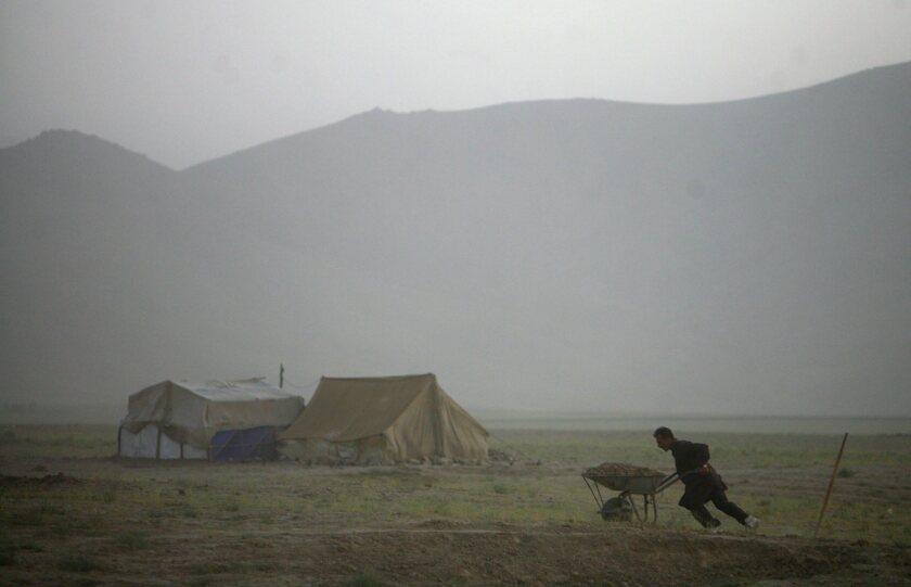 A displaced Afghan works in Barikab, Afghanistan.