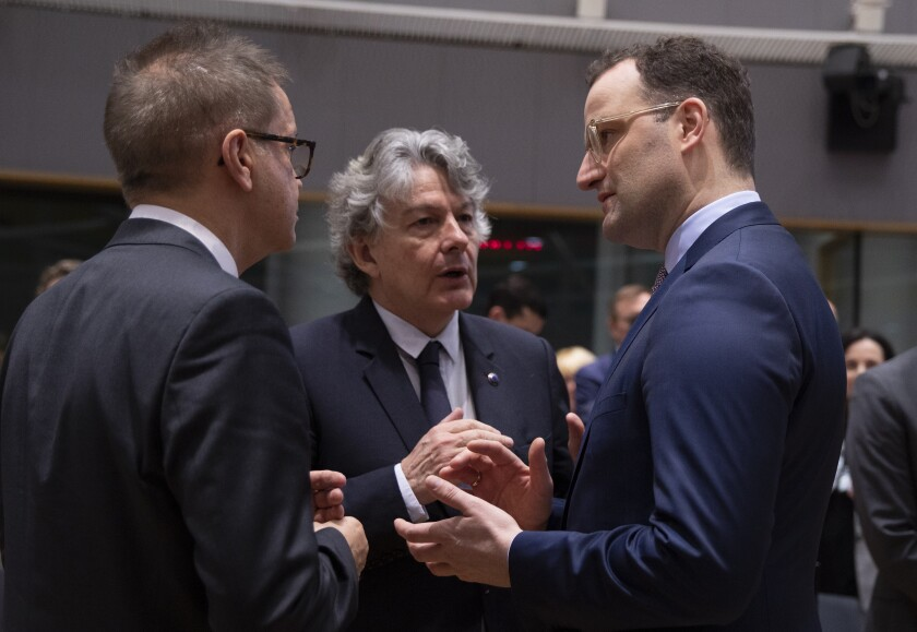 German Health Minister Jens Spahn, right, speaks with Austrian Health Minister Rudolf Anschober, left, and European Commissioner for Internal Market Thierry Breton, center, during an extraordinary meeting of EU health ministers in Brussels to discuss the virus outbreak, Friday, March 6, 2020. Fearing a possible shortage in medicine and protective masks, health ministers from the European Union are trying to boost their collective response to the novel coronavirus outbreak during an emergency meeting. (AP Photo/Virginia Mayo)