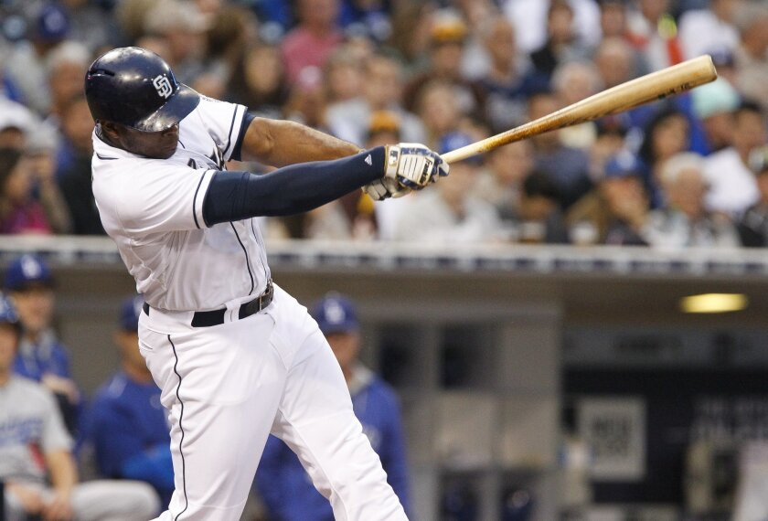 The Padres' Justin Upton hits a single in the first inning.