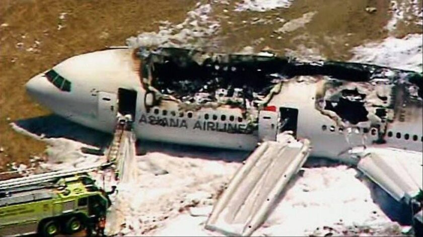 The remains of a Boeing 777 sits on the tarmac in San Francisco. The Asiana Airlines Flight 214 from Seoul, South Korea crashed while landing on Saturday, July 6. Passengers were forced to jump to safety.