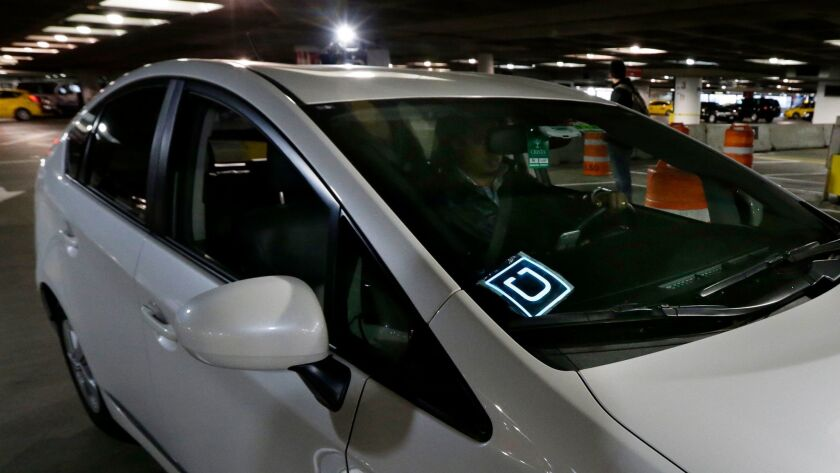 File- This March 31, 2016, file photo shows a driver for Uber Technologies Inc., arriving at an auth