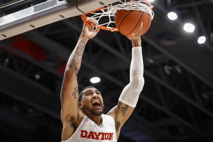 Dayton's Obi Toppin dunks during the first half of an NCAA college basketball game against Houston Baptist, Tuesday, Dec. 3, 2019, in Dayton, Ohio. (AP Photo/John Minchillo)