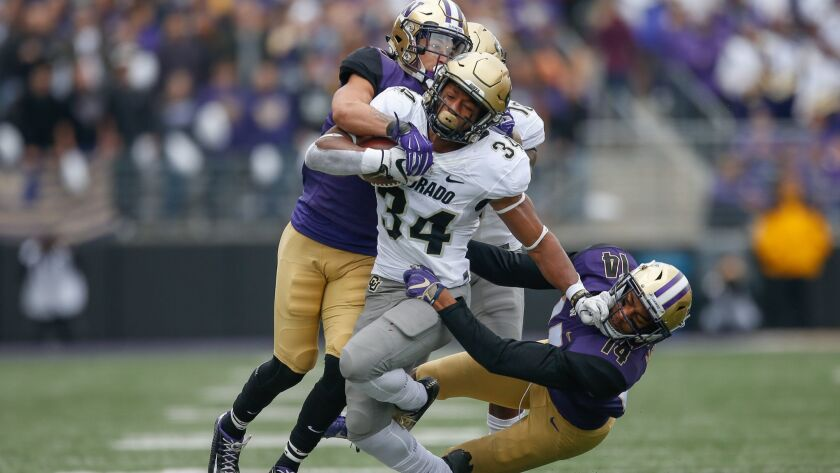 Colorado running back Travon McMillian rushes against Washington at Husky Stadium on Saturday in Seattle.