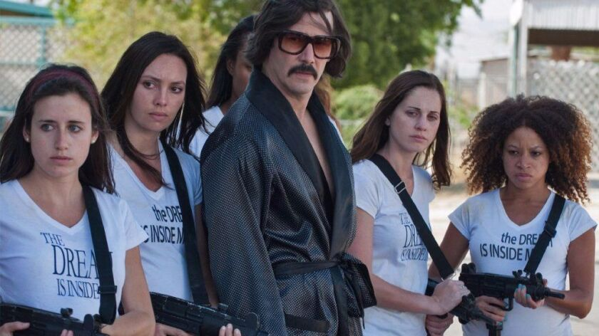 """Keanu Reeves portrays the Dream, shown with his enforcers, in """"The Bad Batch."""""""