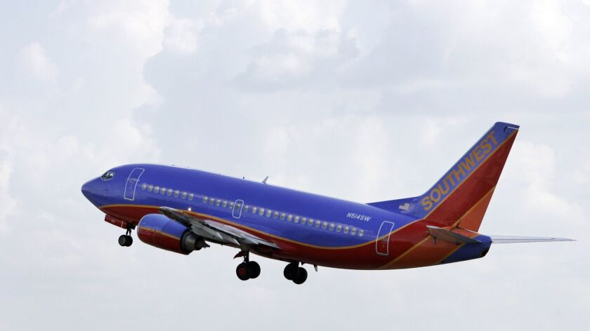 A Southwest Airline jet takes off from Dallas' Love Field in 2007. This week, a Southwest flight on the way to Love Field from Seattle had to turn back after a human heart was left on board.