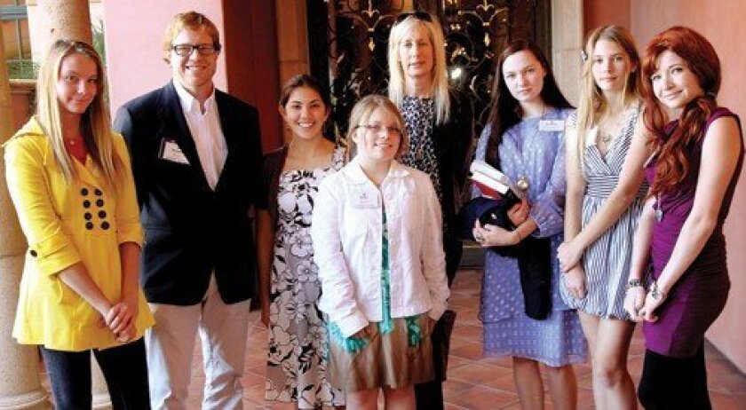 Author Jennet Conant, fifth from left, with San Dieguito Academy students and teachers Kelsey Kanzler, Robert Ross, Brianna Schenkhuizen, Erika Shaw, Brigitte Williamson, Jillian Haines, Lonnie Sefarik