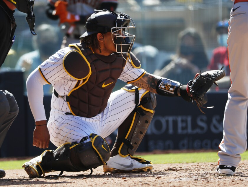 Luis Campusano catches against the San Francisco Giants on April 7.