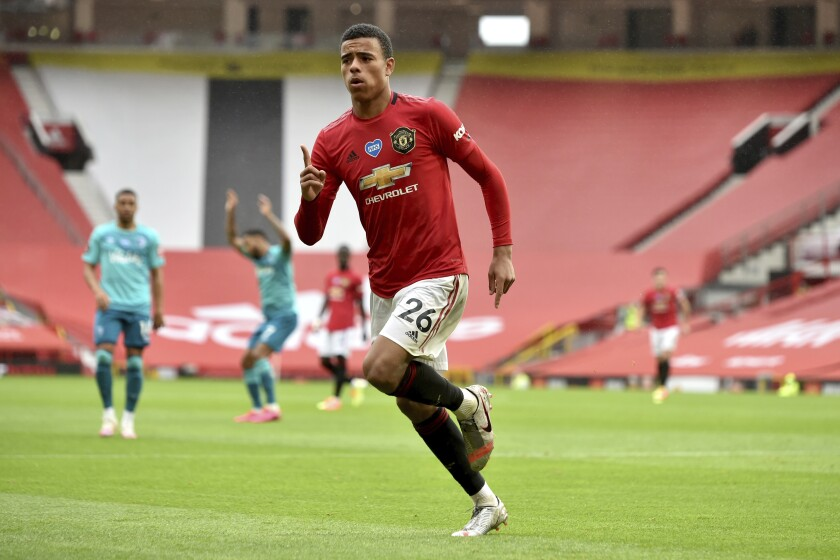 Manchester United's Mason Greenwood celebrates after scoring a goal during the English Premier League soccer match between Manchester United and Bournemouth at Old Trafford stadium in Manchester, England, Saturday, July 4, 2020. (Peter Powell/Pool via AP)