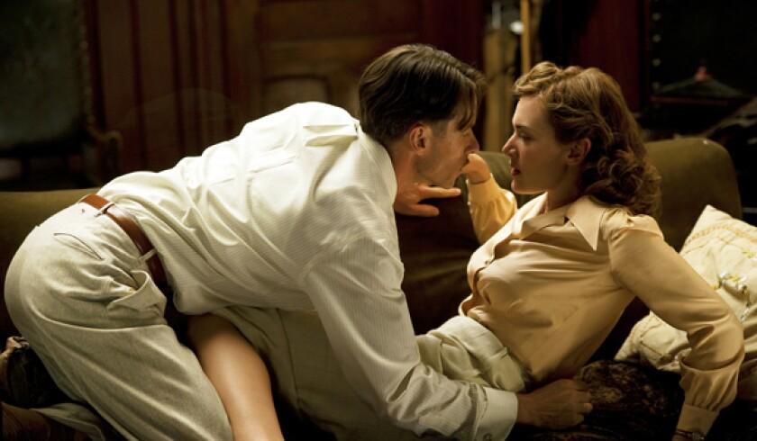 "Guy Pearce and Kate Winslet in a scene from ""Mildred Pierce."""