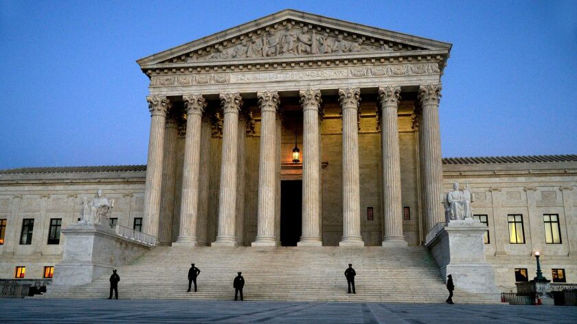 Police officers stand in front of the Supreme Court on Monday, Jan. 30 in Washington.