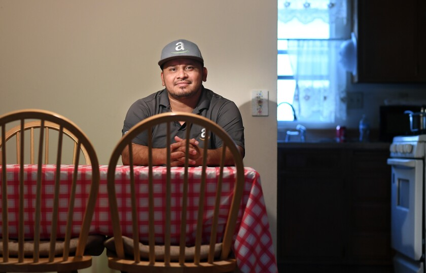 Angel Echeverria, who delivers packages for Amazon, at home in Baldwin Park.