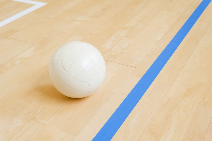 Volleyball ball on hardwood volleyball court